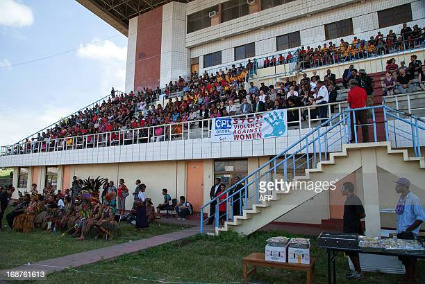Hundreds of women gather for a national 'haus krai' day of mourning in Port Moresby on May 15 2013 Papua New Guinea's Prime Minister Peter O'Neill at...