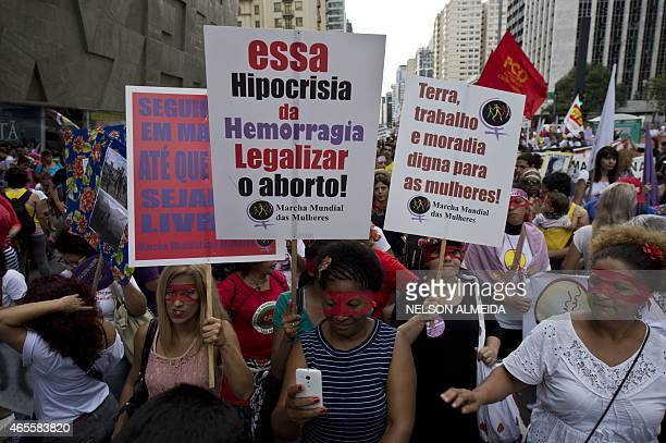 Hundreds of women march along Paulista Avenue in Sao Paulo Brazil on March 8 2015 in celebration of the International Women's Day AFP PHOTO / NELSON...