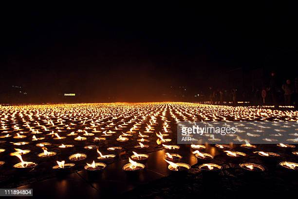 Hundreds out of 26105 burning candles are pictured as Amnesty International established a new world record on June 4 2008 representing the logo of...