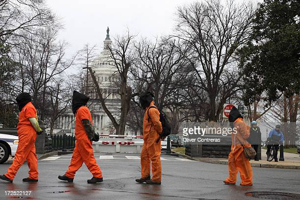 Hundreds protest on 10th anniversary of Guantanamo. Demonstrators marched from the Withe House to Capitol Hill. Washington, DC