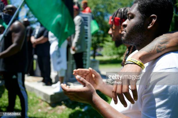 Hundreds take part in a Black Men Rising march and rally to protest police brutality equality social justice and the removal of names and monuments...