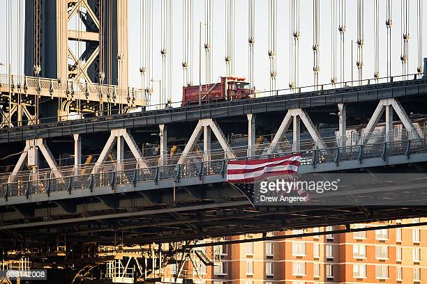 Hung by antiDonald Trump protestors an upside down American flag hangs from the side of the Manhattan Bridge on November 14 2016 in New York City...