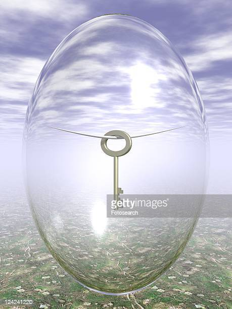 Hung key inside oval shaped glass