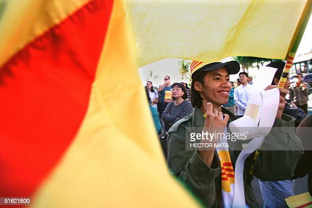 Hung Nguyen a Vietnamese immigrant holds a flag of a former Vietnamese regime near the entrance of a video shop 27 February in Little Saigon...