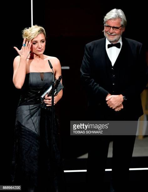 Hungarian actress Alexandra Borbely delivers a speech next to Austrian actor Peter Simonischek after receiving the European actress 2017 award during...