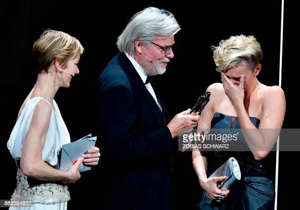 Hungarian actress Alexandra Borbely reacts as she receives the European actress 2017 award next to German actress Sandra Hueller and Austrian actor...