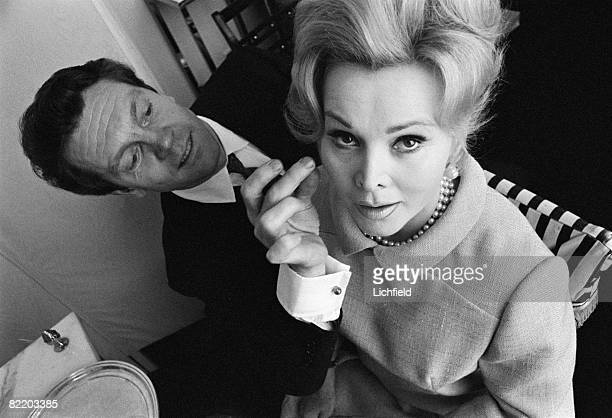 Hungarian actress and socialite Zsa Zsa Gabor having her hair done by Rene of Mayfair 11th May 1965
