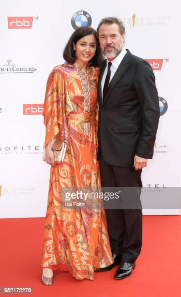 Hungarian actress Dorka Gryllus and german actor Sebastian Koch attend the Lola German Film Award red carpet at Messe Berlin on April 27 2018 in...