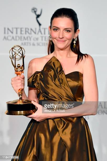 Hungarian actress Marina Gera poses in the press room with the award for Best Performance by an Actress for Orok Tel during the 47th Annual...