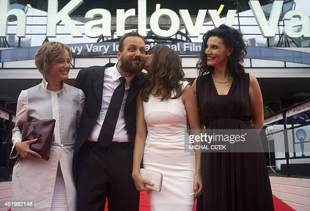 Hungarian actress Nora Horich director Gyorgy Palfi actresses Marina Gera and Timea Buza arrive on the red carpet prior to the presentation of their...