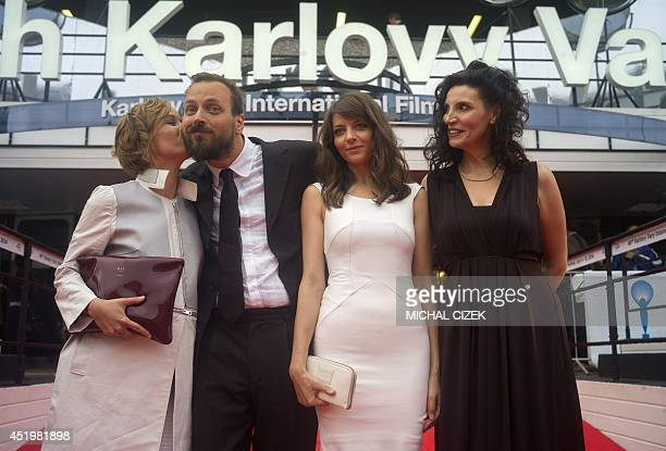 Hungarian actress Nora Horich embraces Hungary director Gyorgy Palfi as they arrive with Hungarian actresses Marina Gera and Timea Buza on the red...