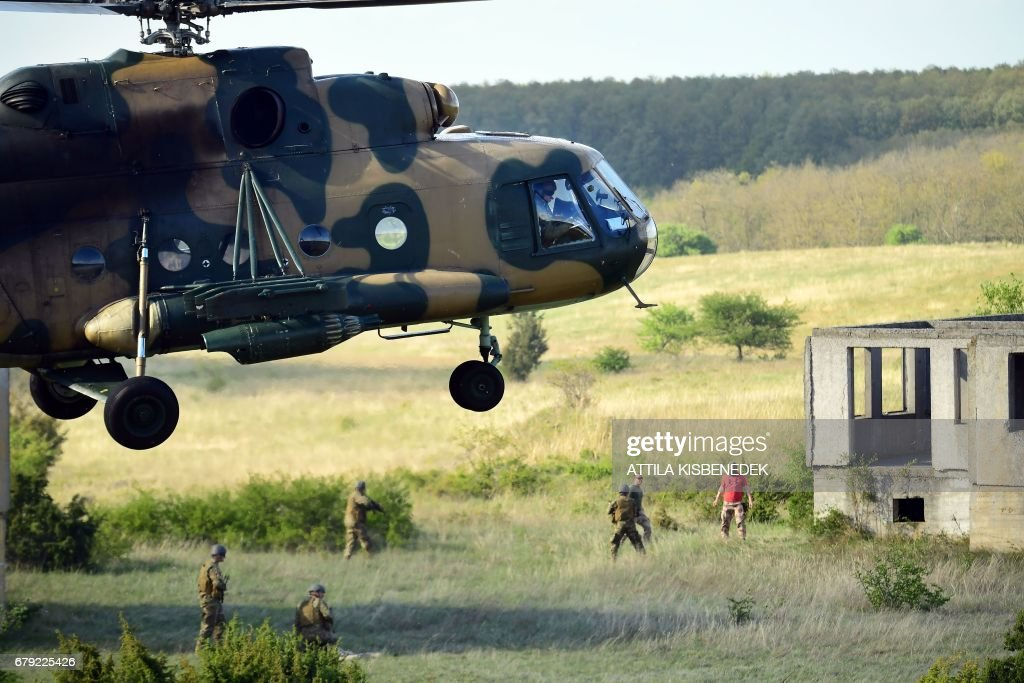 A Hungarian Air Force transport helicopter lands during a hospital