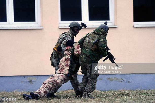 Hungarian and American soldiers take part in a a joint military training exercise at Papa military air base on February 26 2015 Between 22 February...