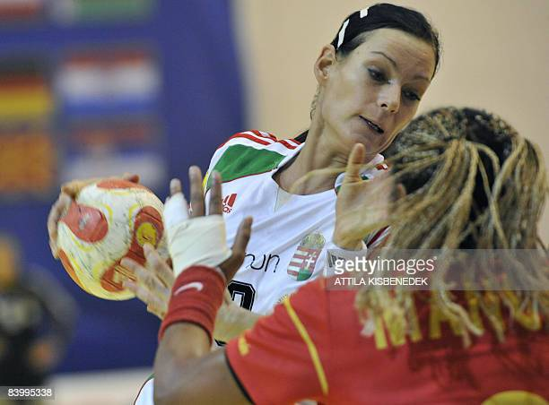 Hungarian Anita Goerbicz fights for the ball with Spanish Marta Mangue during the 8th Women's Handball European Championships match on December 11...