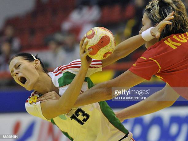 Hungarian Anita Goerbicz is fouled by Spanish Zornitza Koleva during the 8th Women's Handball European Championships match on December 11 2008 in...
