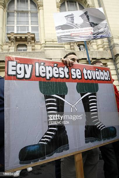 Hungarian antifascist protestors hold up a poster reading Not one step further as they demonstrate against the unveiling of a statuebust of Hungary's...