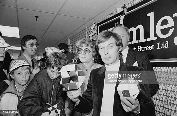 Hungarian architect and inventor of the Rubik's Cube Erno Rubik pictured holding examples of his puzzle Rubik's Snake at a launch party at Hamleys...