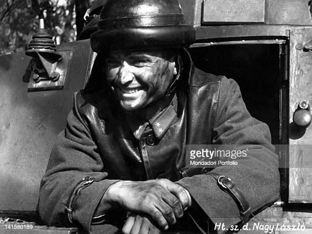 A Hungarian army soldier looks smiling out of his tank on his return from a mission in the River Dniester area on the Russian front July 1941