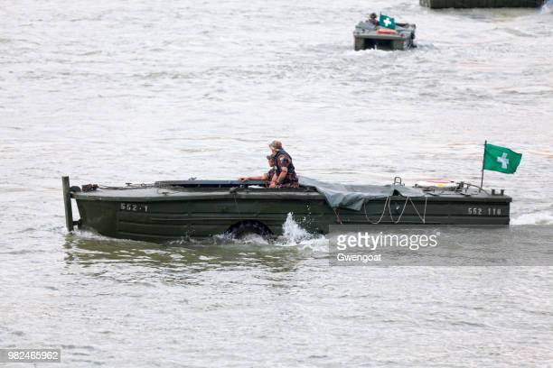 hungarian army soldiers inside an amphibious vehicle - gwengoat stock pictures, royalty-free photos & images