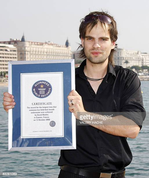 Hungarian artist David Merlini presents his world record certificate at the 24th edition of the fiveday MIPCOM on October 14 2008 in Cannes southern...