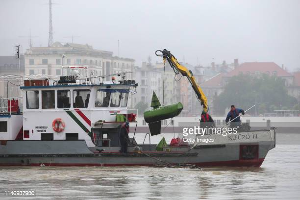 Hungarian authorities search for remains from a tourist boat that capsized on the Danube river the night before killing at least seven people on May...