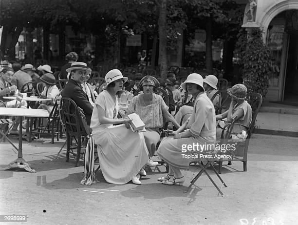Hungarian born Jennie Dolly and her twin sister Rosie drinking tea with Madame de Brissac in Deauville. They became world famous as the Dolly...
