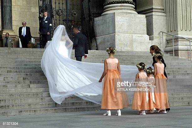 Hungarian bride Andrea Meszaros walks up the steps to the Basilica in Budapest where she is to marry Carlo Ponti the son of Sophia Loren 18 September...