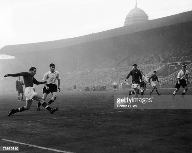 Hungarian centreforward Nandor Hidegkuti scores his team's 6th goal in the match against England at Wembley 25th November 1953 England player Jimmy...