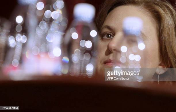 Hungarian chess Olympic winner Judit Polgar answers AFP's questions during an interview with her father, the Hungarian chess teacher and educational...