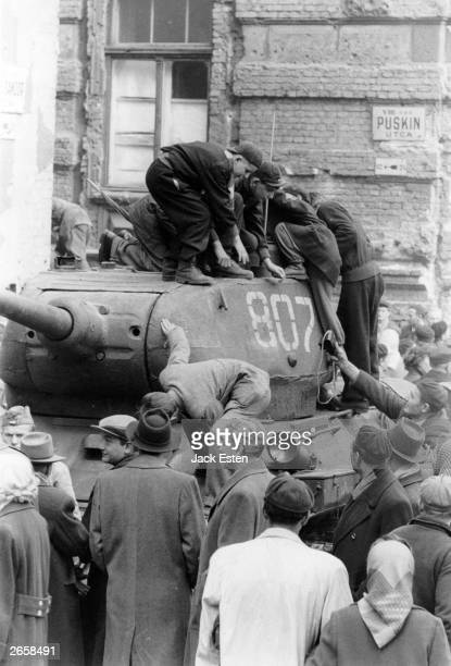 Hungarian citizens climb on a Russian tank during the Hungarian Uprising Original Publication Picture Post 8730 Hungary's Last Battle For Freedom pub...
