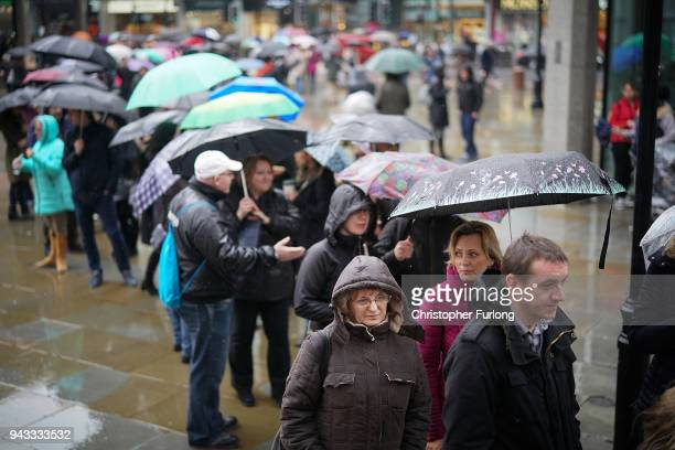 Hungarian citizens queue in the rain to cast their ballots in the Hungarian Parliamentary election on April 8 2018 in London United Kingdom...