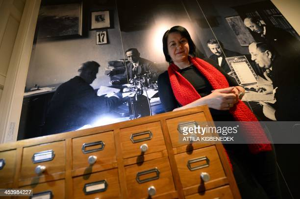STORY Hungarian curator of Hungarianborn US photographer Robert Capa's photo exhibition Eva Fisli poses at the exhibition in the Hungarian National...