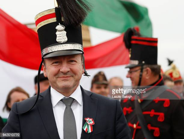 Hungarian Defence Minister Istvan Simicsko dressed as Hungarian Hussars attends a reenactment of the Battle of Tapiobicske on April 4 2018 near...