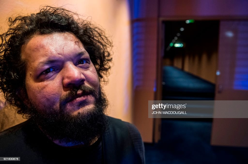 Hungarian director of Roma origin Arpad Bogdan, 37, who premiered his second feature film 'Genesis' during the Berlinale film festival, poses in the Berlinale Palast in Berlin on February 19, 2018. / AFP PHOTO / John MACDOUGALL / TO