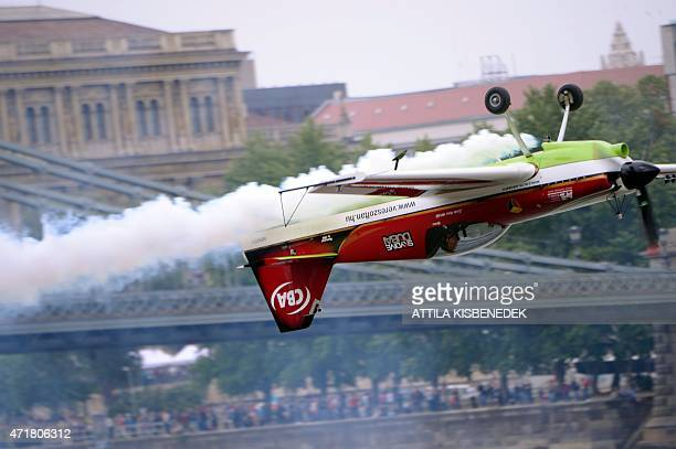 Hungarian European champion and Guinness recorder Zoltan Veres performs near the oldest Hungarian bridge the 'Lanchid' on May 1 2015 during a flying...