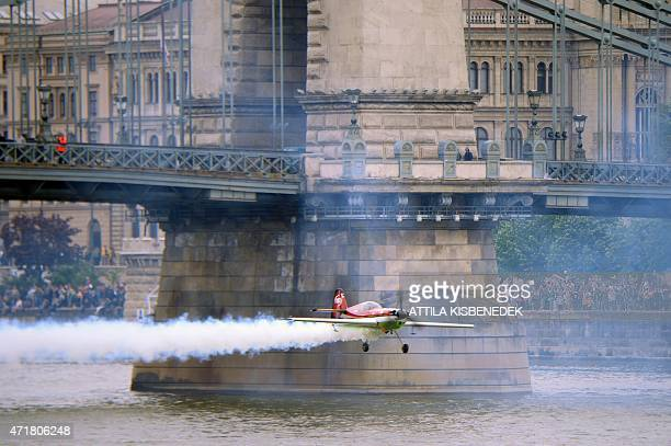Hungarian European champion and Guinness recorder Zoltan Veres performs under the oldest Hungarian bridge the 'Lanchid' on May 1 2015 during a flying...