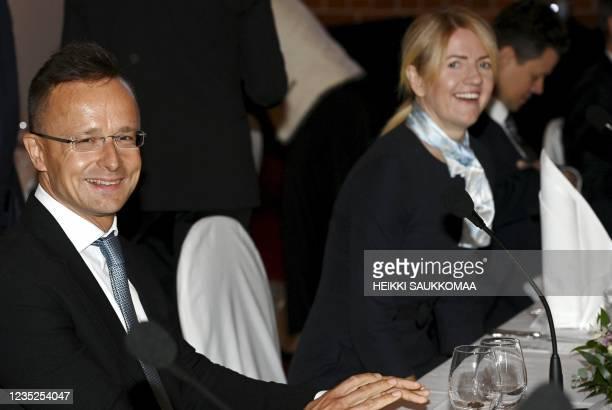 Hungarian Foreign Minister Peter Szijjarto and Estonian Foreign Minister Eva-Maria Liimets attend a dinner after a meeting of foreign ministers of...