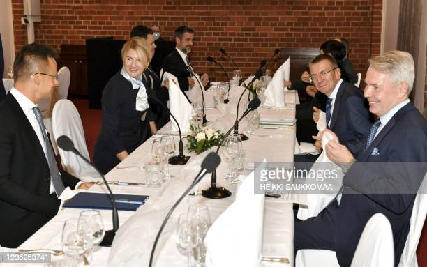 Hungarian Foreign Minister Peter Szijjarto and Estonian Foreign Minister Eva-Maria Liimets Latvian Foreign Minister Edgars Rinkevics and Finland's...