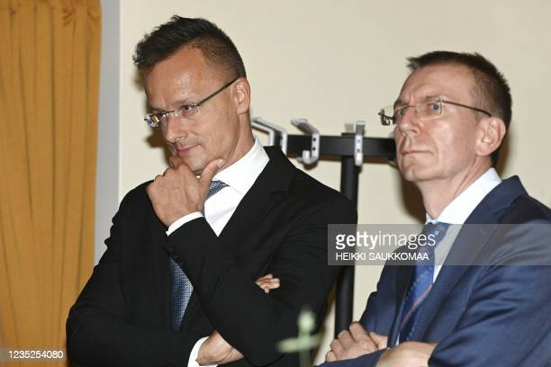 Hungarian Foreign Minister Peter Szijjarto and Latvian Foreign Minister Edgars Rinkevics attend a dinner after a meeting of foreign ministers of the...