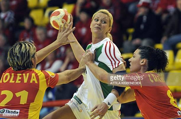 Hungarian Gabriella Szucs prepares her shot against Spanish Veronica Cuadrado and Zornitza Koleva during the 8th Women's Handball European...