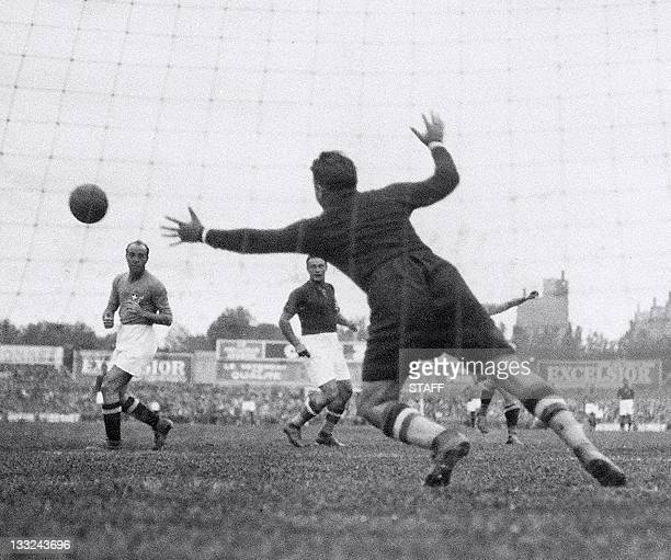 Hungarian goalkeeper Antal Szabo tries to stop a shot from Italian forward Giovanni Ferrari during the World Cup final between Italy and Hungary 19...