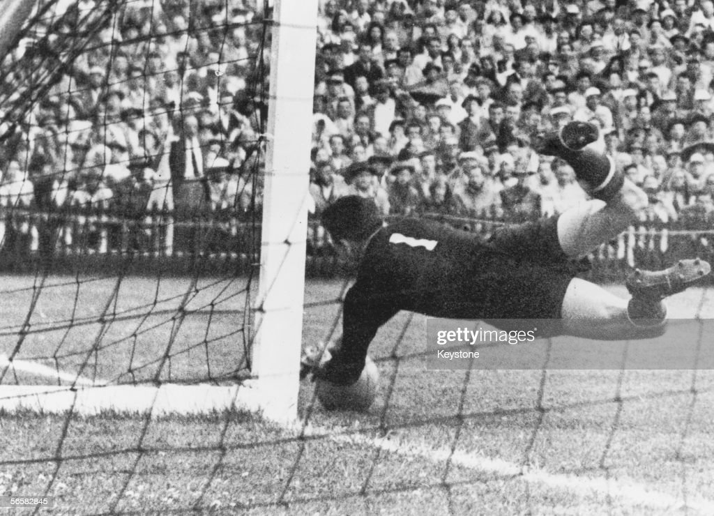 Hungarian goalkeeper Gyula Grosics makes a save during a World Cup quarterfinal against Brazil at the Wankdorf Stadium, Berne, Switzerland, 27th June 1954. Hungary won the match 4-2.