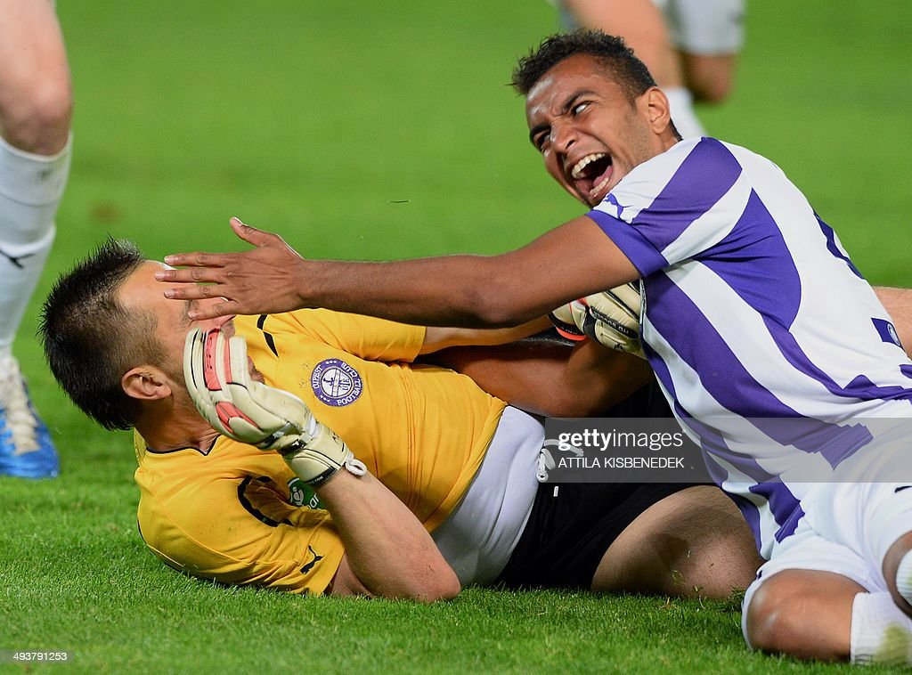 Hungarian goalkeeper Szabolcs Balajcza (L) and Peter Kabat (R) of TE Ujpest celebrate their victory after the Hungarian Cup final football match VTK Disosgyor vs TE Ujpest on May 25, 2014 at the Puskas stadium in Budapest. Ujpest won the match 6-5 after a penalty shootout.
