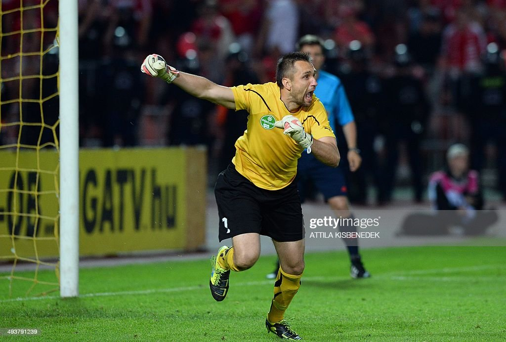 Hungarian goalkeeper Szabolcs Balajcza of TE Ujpest celebrates their victory after the Hungarian Cup final football match VTK Disosgyor vs TE Ujpest on May 25, 2014 at the Puskas stadium in Budapest. Ujpest won the match 6-5 after a penalty shootout.