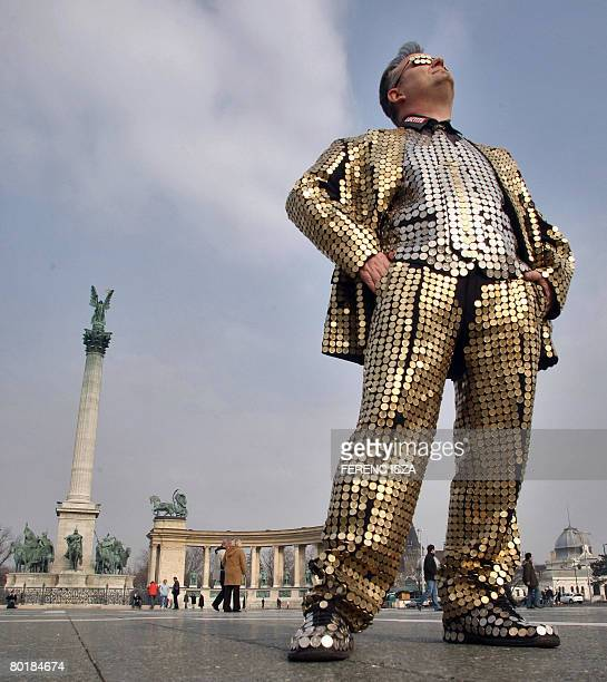 Hungarian graphic artist Tibor Gaal also known as TBoy stands in Heroes Square in Budapest with his handmade 'tie of coins' outfit on March 10 2008...