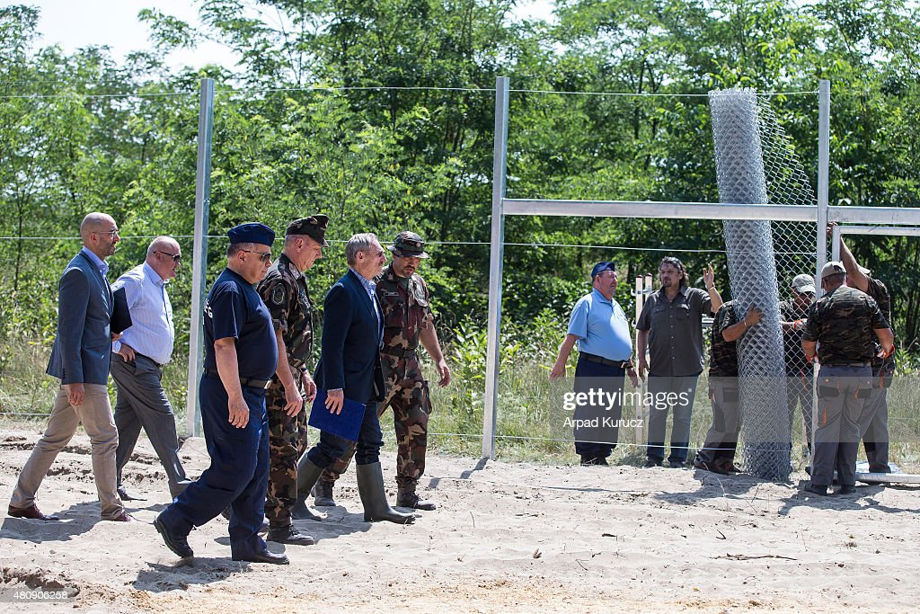 Hungarian interior minister Sandor Pinter (2ndR) and Hungarian Defence Minister Csaba Hende (2ndL) inspect the first portion of a temporary fence the Hungarian military is erecting on its border to Serbia in an effort to keep out refugees on July 16, 2015 at Morahalom near Szeged, Hungary. Hungary has become one of the main crossing points, especially for refugees from Syria, Afghanistan and Iraq, who arrive to Europe via Greece and travel through Serbia and Hungary on their way to countries in northern Europe like Germany and Sweden.