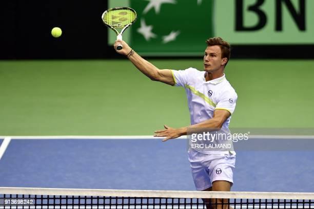 Hungarian Marton Fucsovics hits a return against Belgians Ruben Bemelmans and Joris De Loore during the Davis Cup World first round double tennis...
