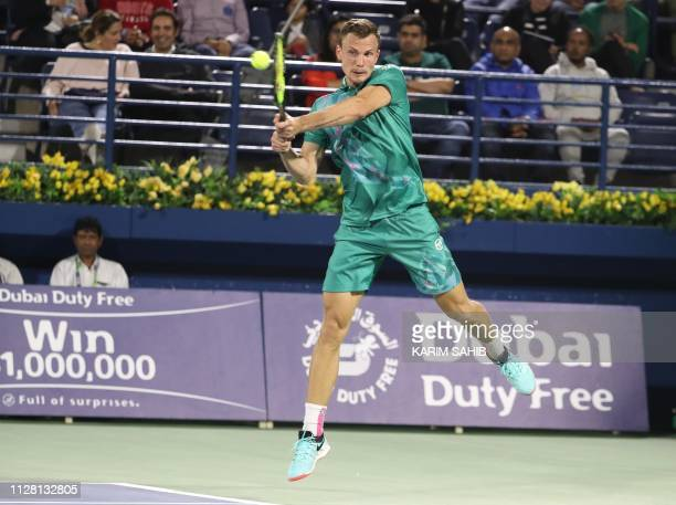Hungarian Marton Fucsovics returns the ball to Swiss Roger Federer during their quarter final match at the ATP Dubai Duty Free Tennis Championship in...
