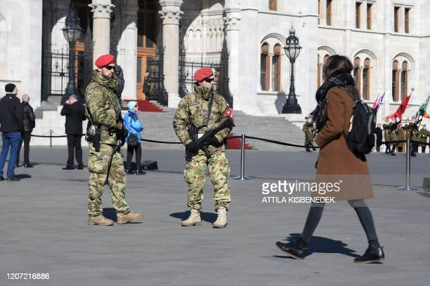Hungarian military police stand guard during a flaghoisting ceremony to mark the anniversary of the Hungarian Revolution on March 15 2020 in front of...
