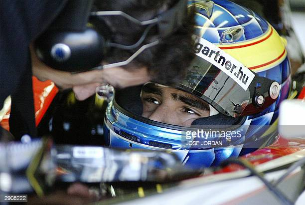 Hungarian Minardi F1 driver Szolt Baumgartner talks to a technician during a practice session at the Ricardo Tormo circuit, in Cheste near Valencia,...